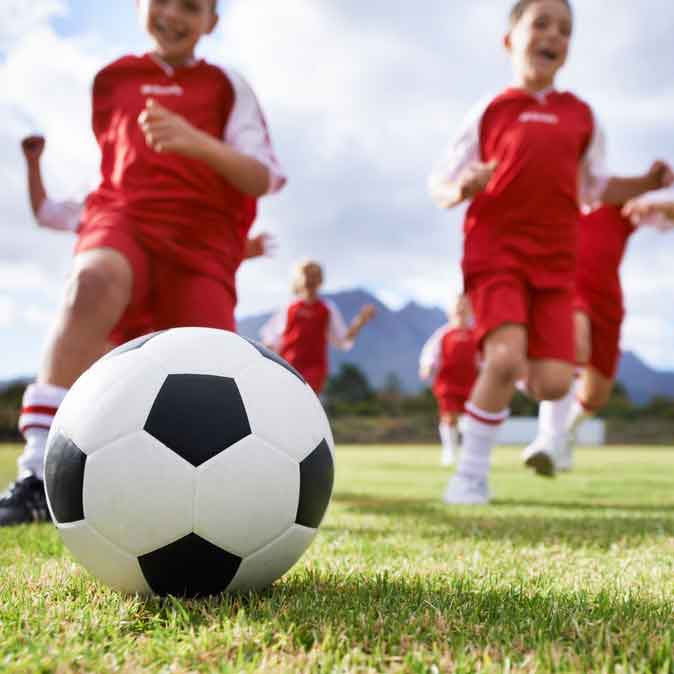 healthy children playing soccer